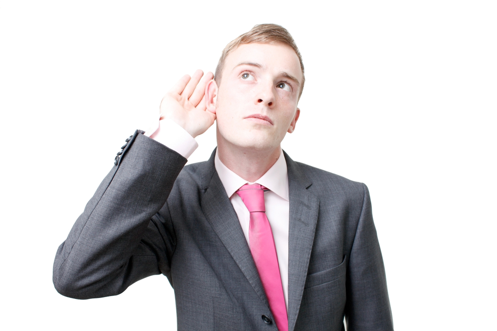 art_of_listentin_a_business_man_listening_isolated_on_whiteview_image_at_1000px_save