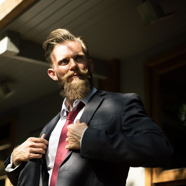 Attitude and Success_Bearded man in suit