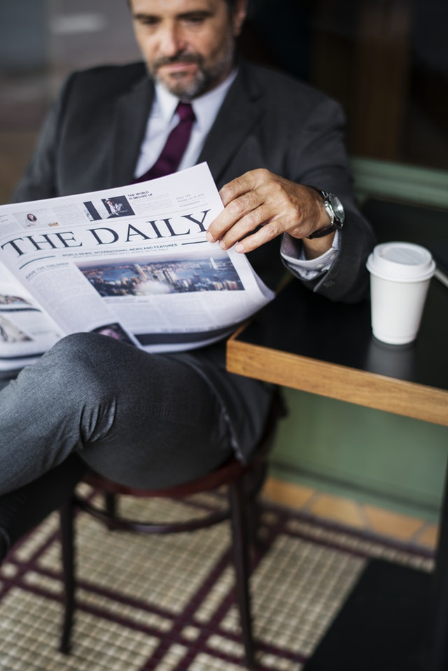 Best Articles of 2018_Business man sitting in a chair reading a newspaper