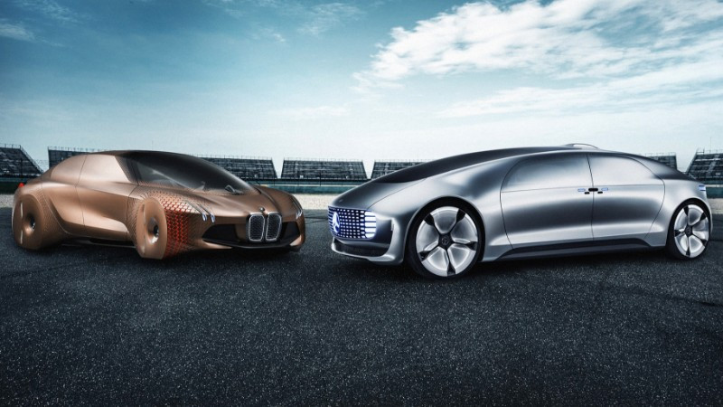 BMW and Mercedes F015 concept shown together in reference to the two firms' joint venture announcement