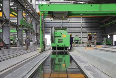 canva_-_people_stands_near_green_metal_industrial_machine__1___1582733816_54_208_16_124
