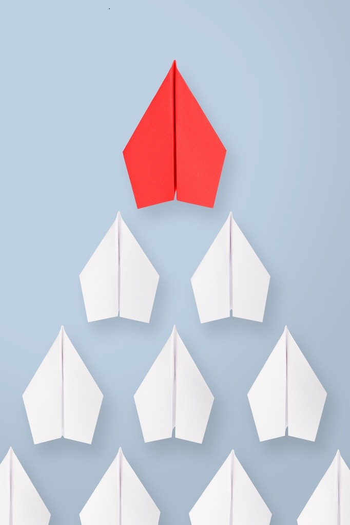HR Leader Development_Leadership concept with red paper ship leading among white