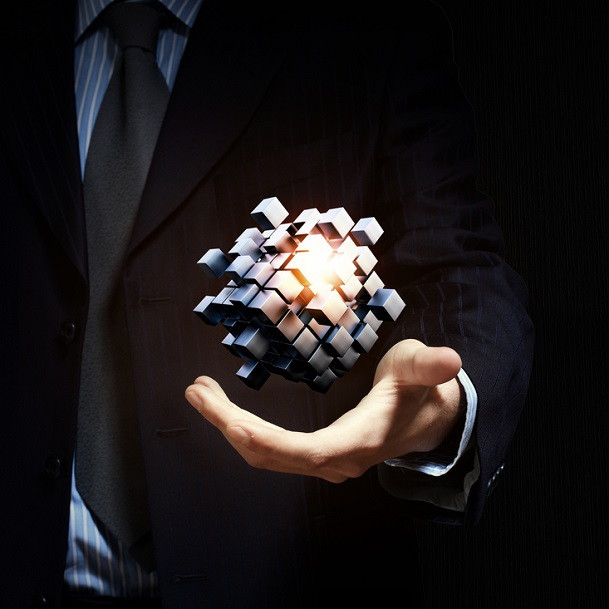 hr transformation and current-state analysis_businessman close view holding in hand magic glowing cube