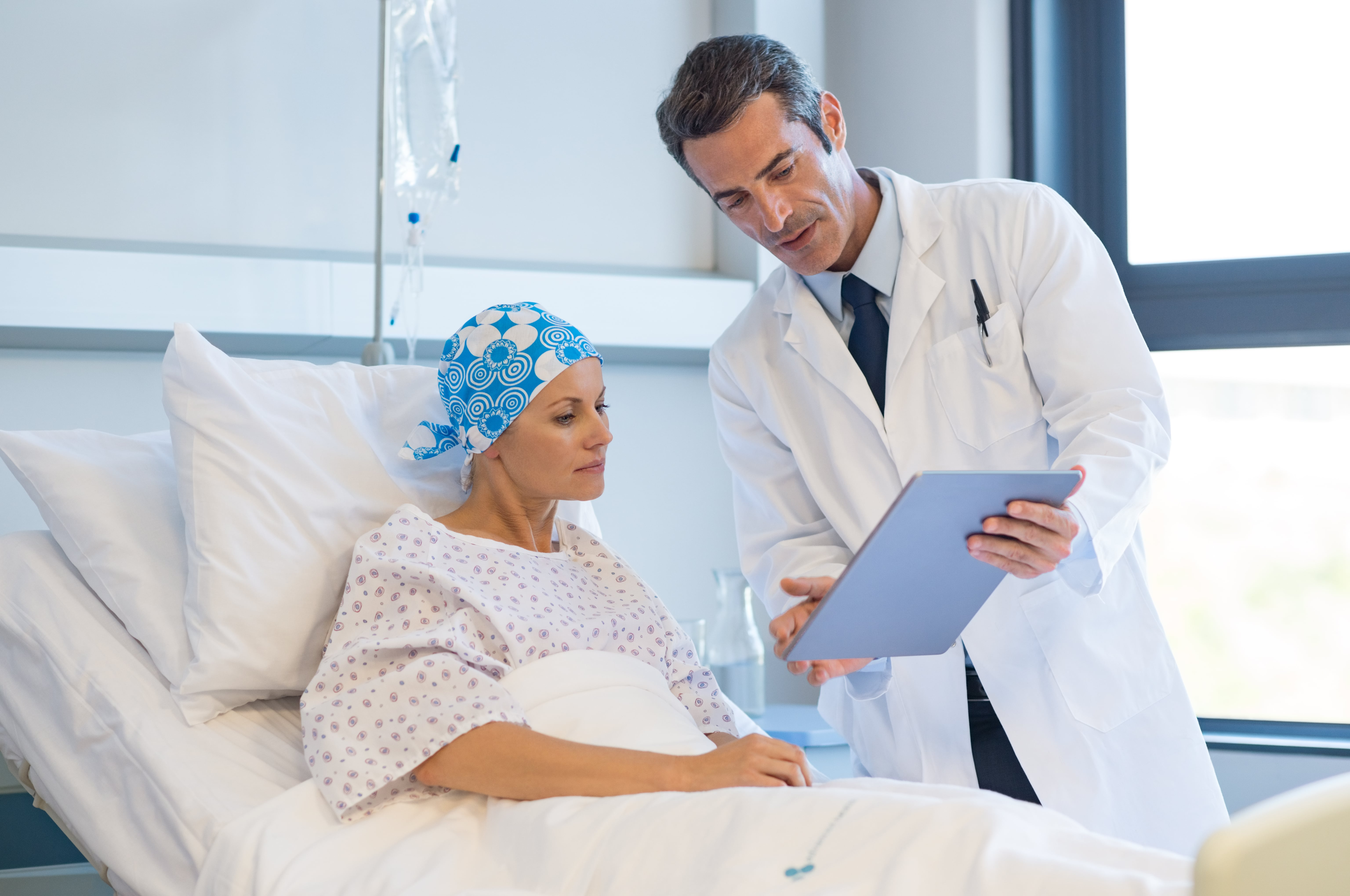 Woman gets cancer diagnosis treatment plan from doctor
