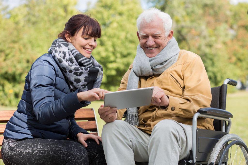 woman making tech accessible for elderly man