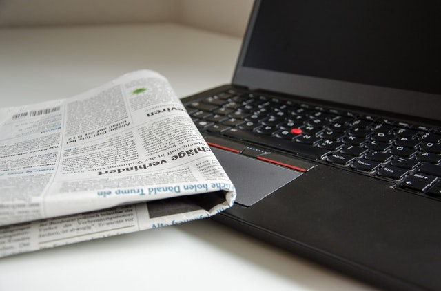 November Top Articles_Newspaper laying ont op of a laptop computer