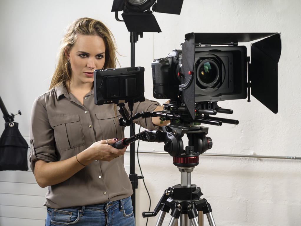 Recruiting Video_Photo of a woman operating a dslr camera rig for a video shoot