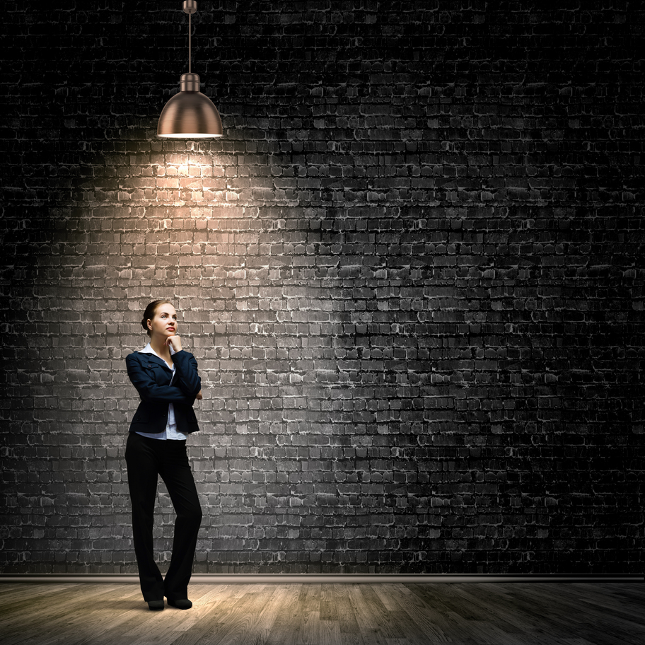 Recruitment_Image of young businesswoman standing under spot of light