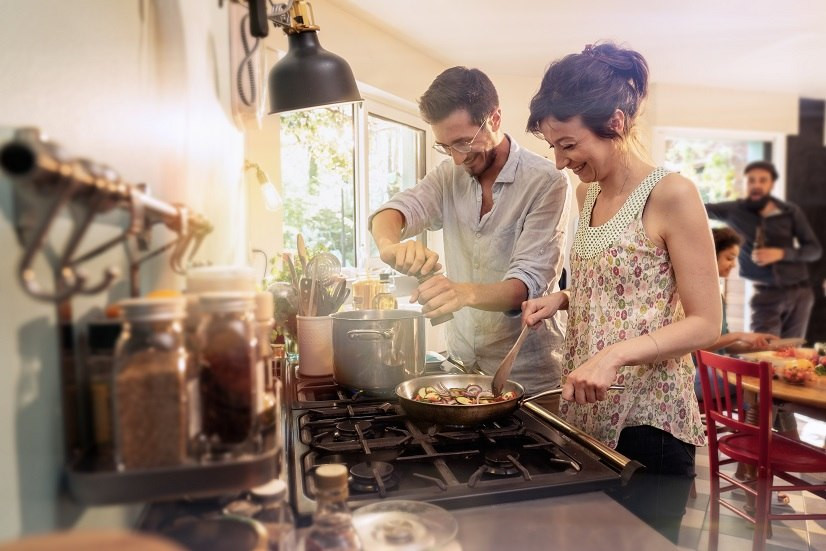 couple-cooking-in-kitchen