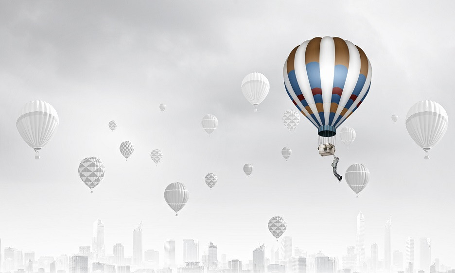 Talent Acquisition Guide_Businessman flying in search of ideas hanging on balloon. Search for new business ideas