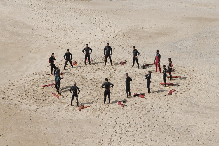 people in a circle on the beach