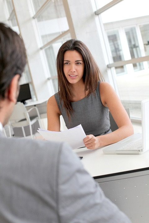 The Art of Getting Hired_Businesswoman interviewing job applicant