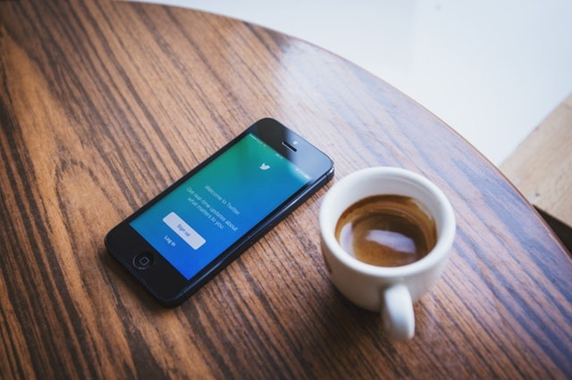 Top 10 Workplace Culture Influencers on Social Media _coffee smartphone twitter application