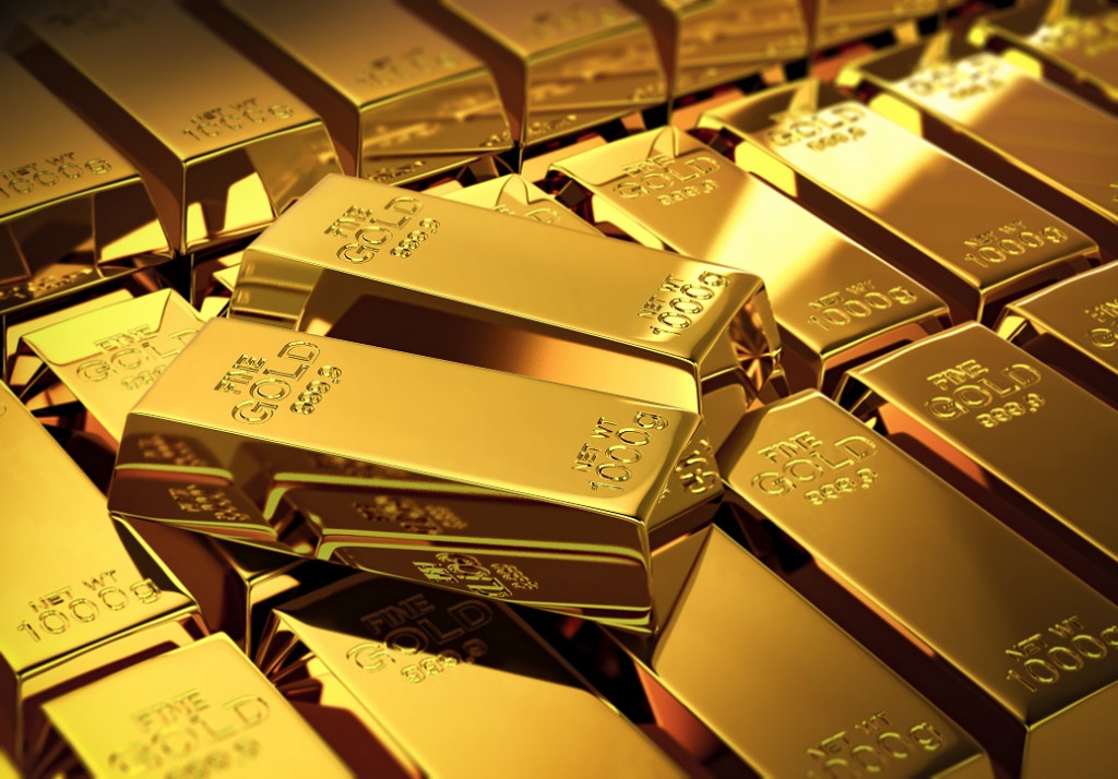 Why Coaching really matters_2 gold bars stacked on a pile of other gold bars