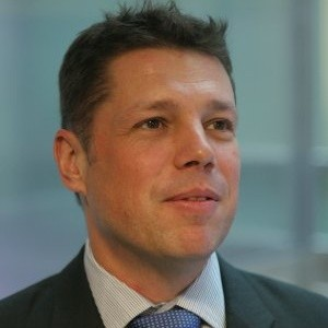 Elliott Hann, Executive Director, Data Solutions at UBS Investment Bank