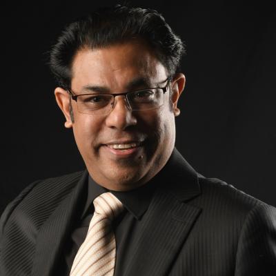 Dr. Raman K. Attri
