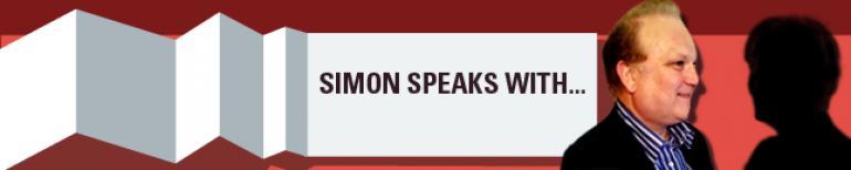 Simon speaks with…