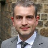 Dr. Frank Charlier
