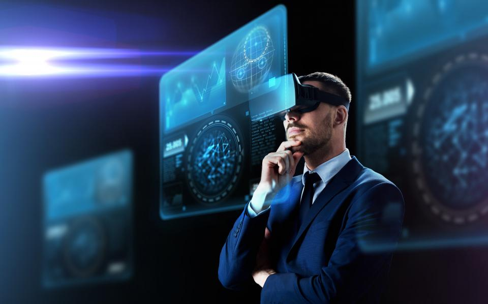 Man wearing VR goggles looking at augemented reality