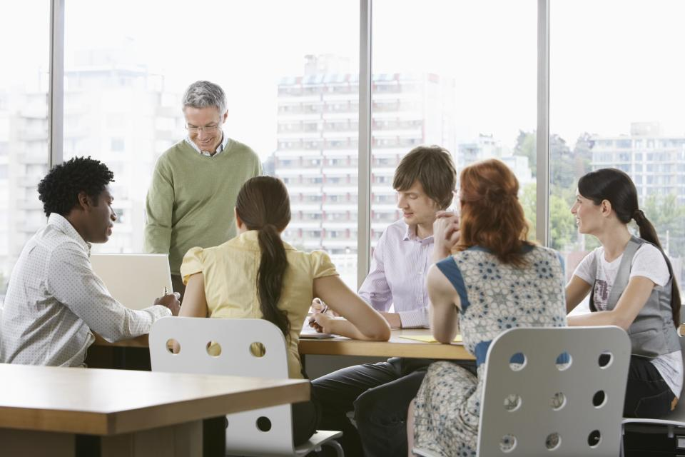 People meeting around a conference table