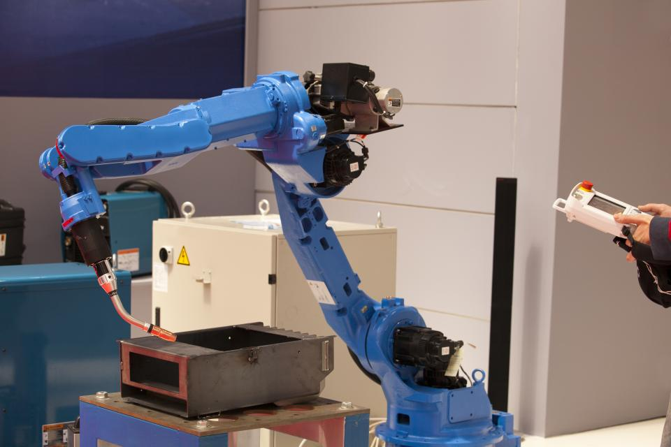 blue robotic arm in use