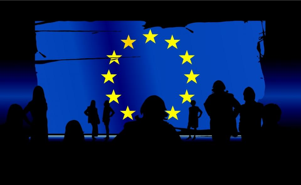 silhouettes of people in front of an European union flag