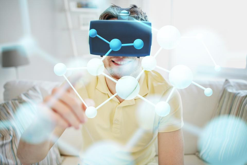 man using VR headset to construct modules