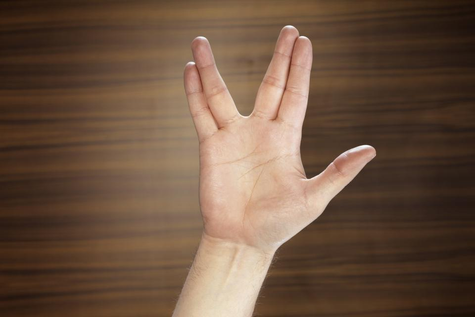 Male hand making Vulcan salute