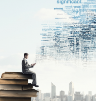 Businessman using mobile. Young businessman sitting on pile of books