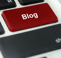A keyboard with a red button blog surrounded by black buttons