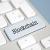 Blockchain written on a silver keyboard