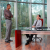 Two Businessmen in Office with forest view in background