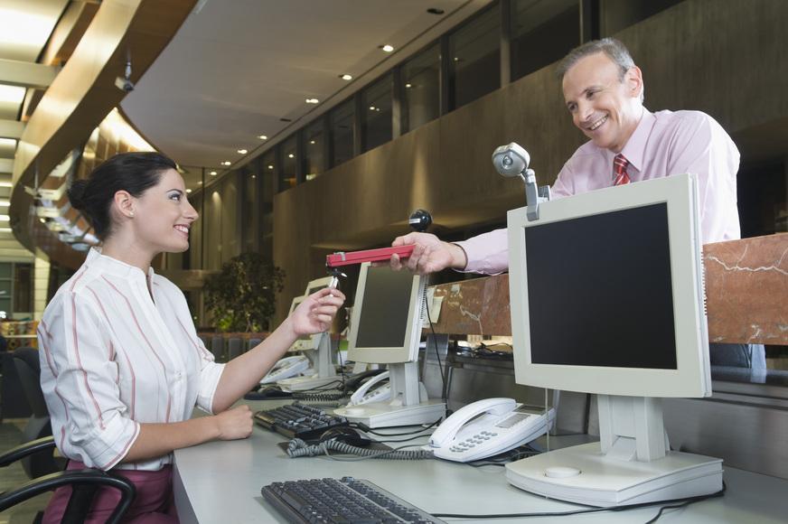 Female customer service representative rewarded by her boss