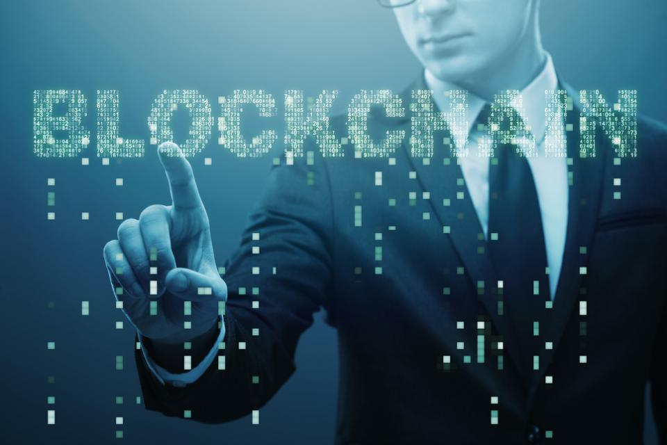 Blockchain on blue with digital letters