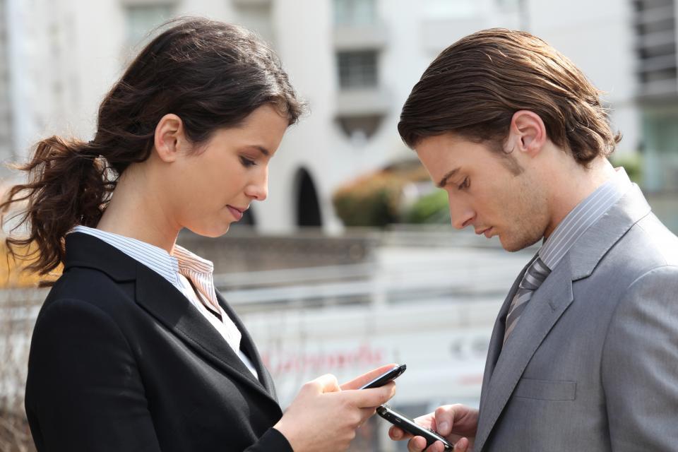 Woman and Man Walking and Texting