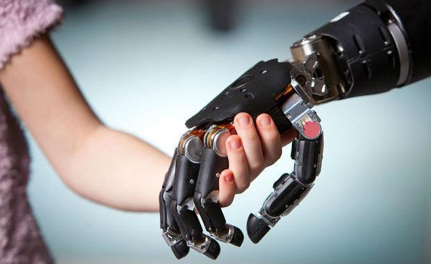 Child holding robots hand courtesy Purbat