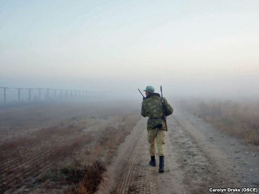 A Tajik border guard patrols the Afghan border, where illegal crossings, robberies, and kidnappings of Tajiks by Afghan drug smugglers are not unusual.