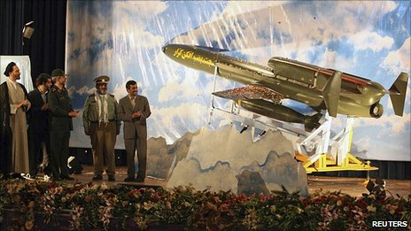 President Mahmoud Ahmadinejad and military officials at the unveiling of a drone in Tehran, 22 August 2010