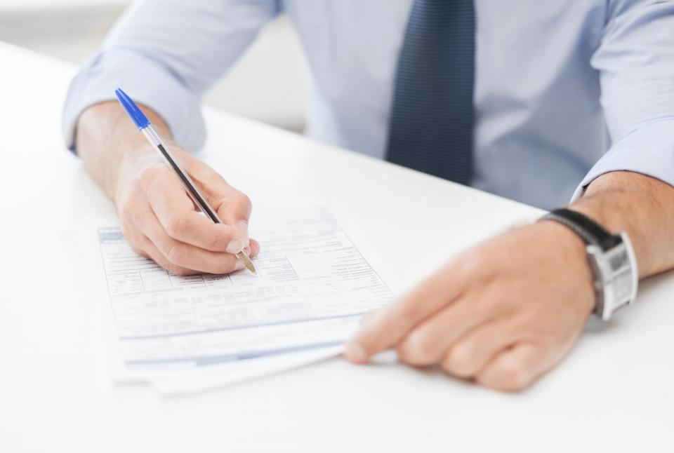 business, office, and education concept - man signing a contract